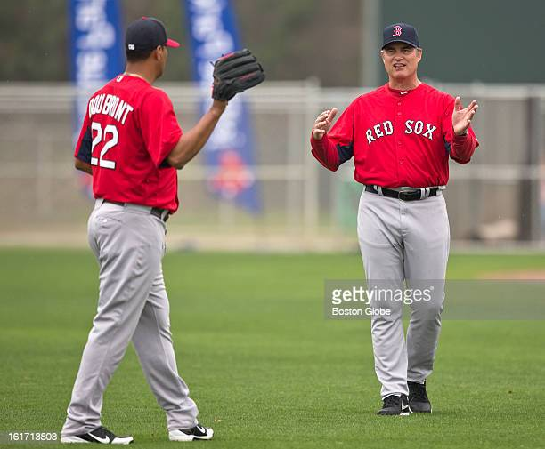 Boston Red Sox manager John Farrell working with pitcher Felix Doubront during a throwing session Day three of spring training at the Red Sox...