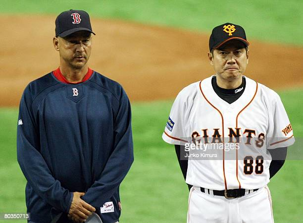 Boston Red Sox manager Terry Francona and of Yomiuri Giants manager Tatsunori Hara line up prior to the start of a preseason friendly game between...