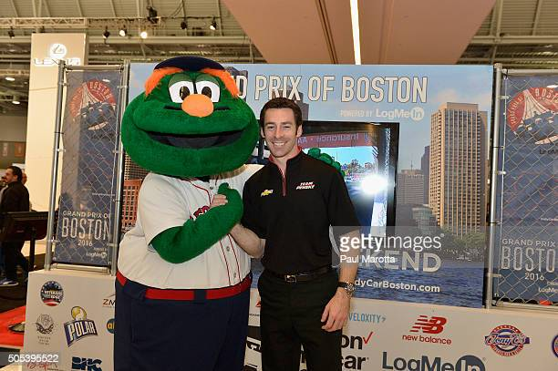 Boston Red Sox Mascot Wally the Green Monster and Team Penske Dallara/Cheverolet Indy Race Car Driver Simon Pagenaud at the Grand Prix of Boston...