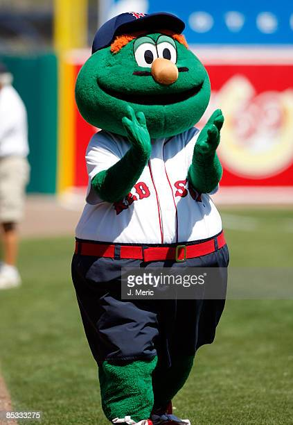 Boston Red Sox mascot Wally the Green Monster claps just prior to the start of the Grapefruit League Spring Training Game against the Baltimore...