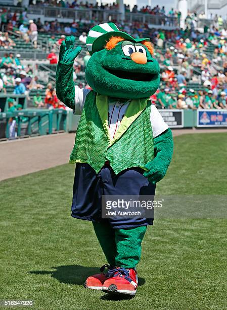 Boston Red Sox mascot Wally the Green Monster waves to fans prior to the spring training game against the Baltimore Orioles at JetBlue Park on March...