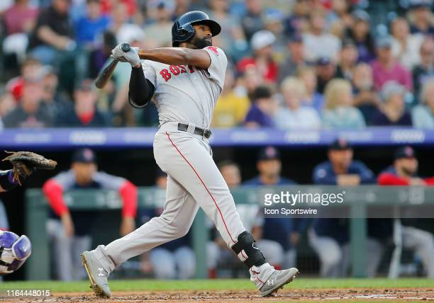 Boston Red Sox outfielder Jackie Bradley connects for a homerun during a game between the Colorado Rockies and the visiting Boston Red Sox on August...