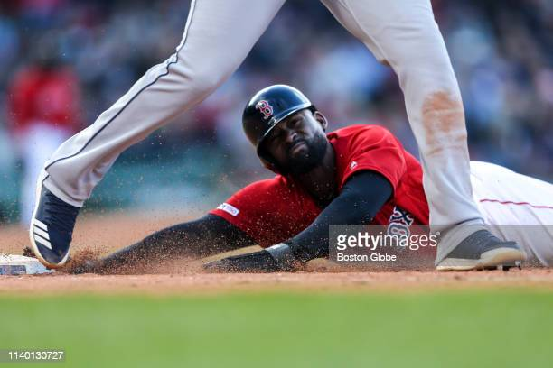 Boston Red Sox outfielder Jackie Bradley Jr slides safely into first base during the seventh inning The Boston Red Sox host the Tampa Bay Rays in a...
