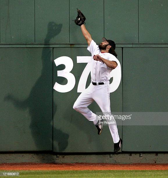 Boston Red Sox outfielder Johnny Damon makes a leaping catch against the Texas Rangers Saturday July 10 2004 The Red Sox won 146 at Fenway Park in...