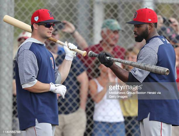 Boston Red Sox outfielders Andrew Benintendi left and Jackie Bradley Jr compare swings during a spring training workout in Fort Myers Florida on...