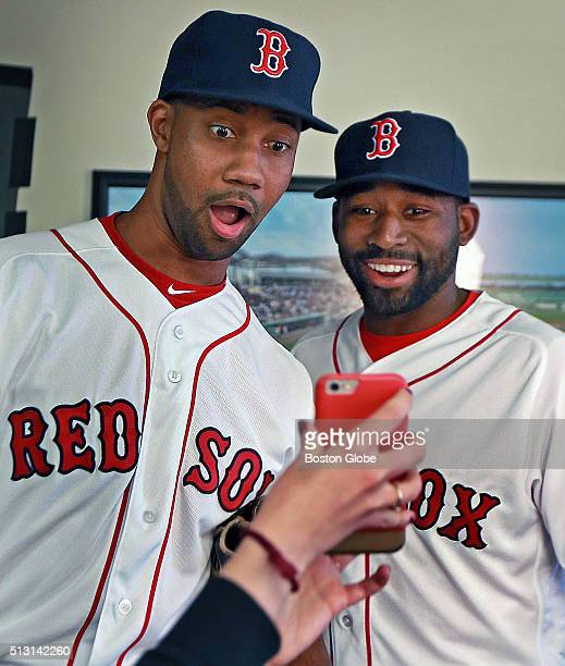 Boston Red Sox outfielders Chris Young left and Jackie Bradley Jr react to a photo of themselves altered using the Snapchat Face Swap program during...