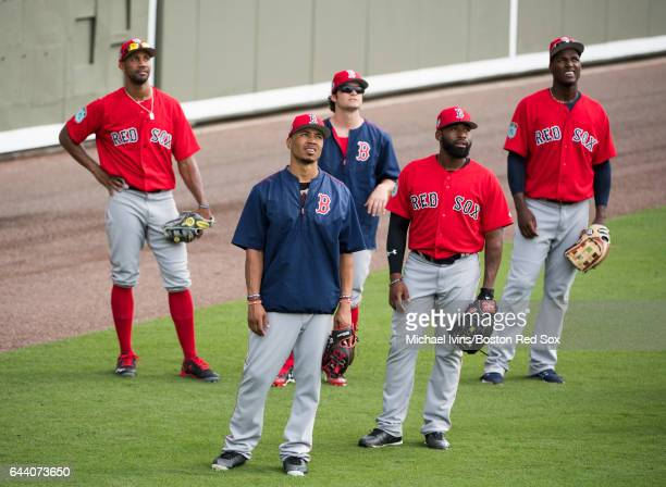 Boston Red Sox outfielders Chris Young Mookie Betts Andrew Benintendi Jackie Bradley Jr #19 and Junior Lake line up to participate in fielding drills...
