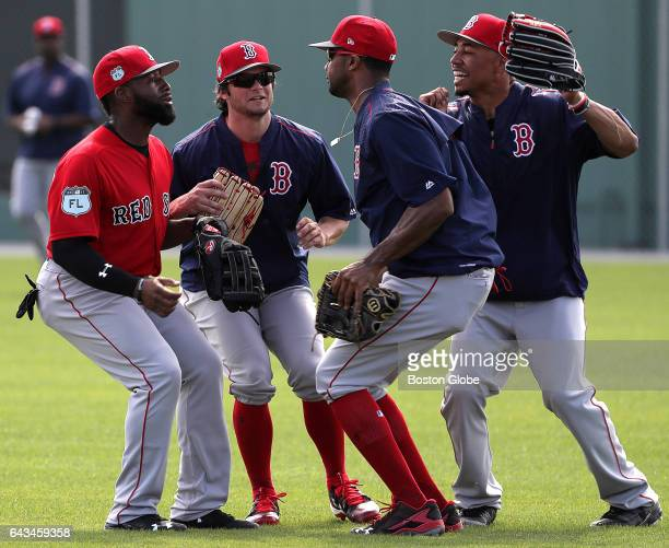 Boston Red Sox outfielders Jackie Bradley Jr Andrew Benintendi Chris Young and Mookie Betts get together in the outfield for a high five fist bump...