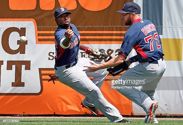 Boston Red Sox outfielders Jackie Bradley Jr left and Corey Brown right try to gain control of a fly ball that landed between them during a spring...
