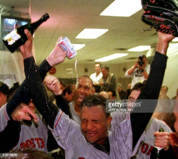 Boston Red Sox Pedro Martinez is sprayed with champagne in the locker room by teammates after they defeated the Cleveland Indians 11 October 1999 in...