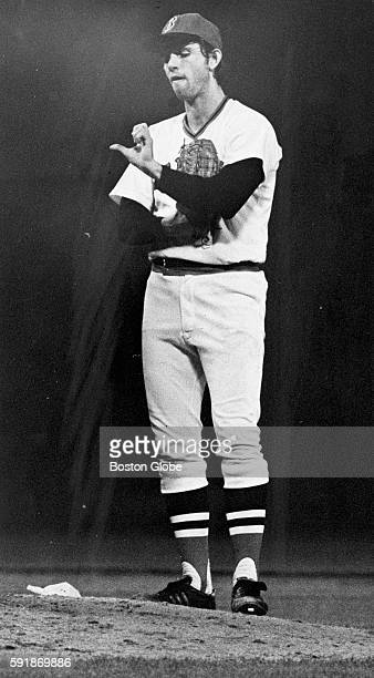 Boston Red Sox pitcher Bill Lee checks his thumb blister during Game Seven of the 1975 World Series against the Cincinnati Reds at Fenway Park in...