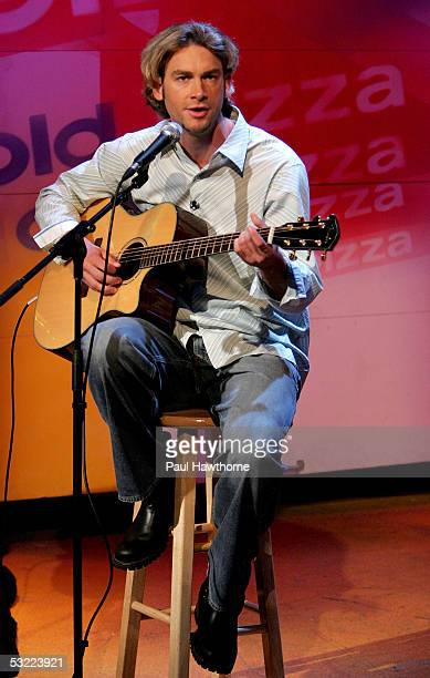 Boston Red Sox pitcher Bronson Arroyo performs a song from his new CD Covering the Bases at ESPN's Cold Pizza studio July 11 2005 in New York City