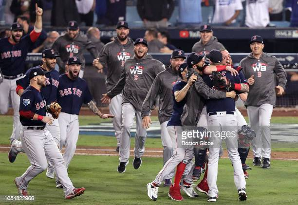 Boston Red Sox pitcher Chris Sale catcher Christian Vazquez and teammates celebrate their Word Series Championship 51 win over the Los Angeles...