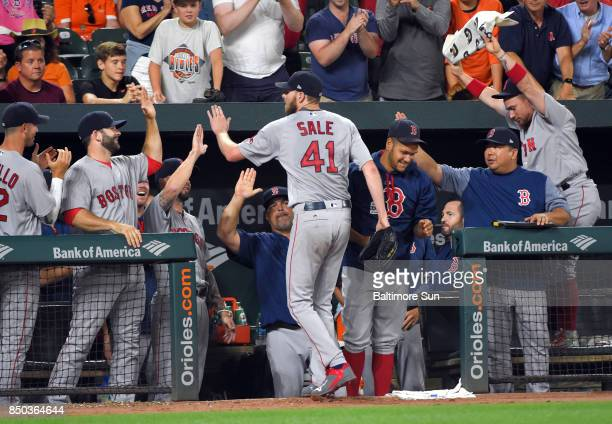 Boston Red Sox pitcher Chris Sale is congratulated by teammates after recording his 13th strikeout of the game and his 300th of the season against...