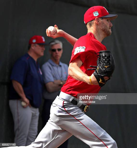 Boston Red Sox pitcher Chris Sale throws a Bullpen session as Boston Red Sox manager John Farrell and Boston Red Sox President of Baseball Operations...