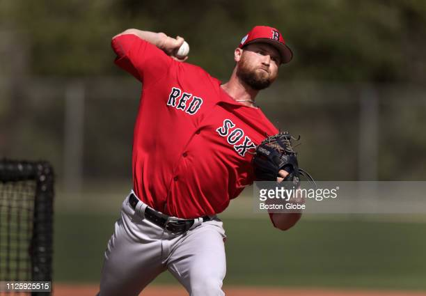 Boston Red Sox pitcher Colten Brewer throws during a live batting practice session during a spring training workout at JetBlue Park in Fort Myers FL...