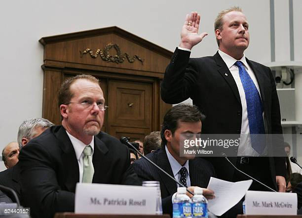 Boston Red Sox pitcher Curt Schilling is sworn in while former major league player Mark McGwire and Baltimore Oriole Rafael Palmeiro listen during a...