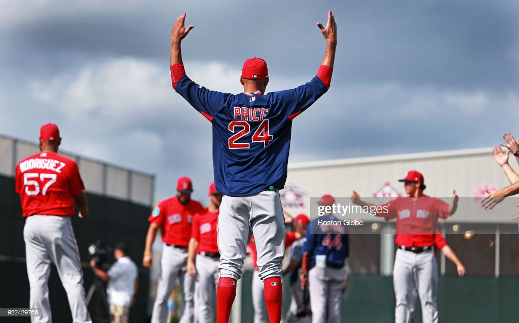 Boston Red Sox pitcher David Price and some of his teammates stretch on the morning of the final day of workouts during spring training at the Player Development Complex at Jet Blue Park in Fort Myers, FL on Feb. 21, 2018. The team begins exhibition games with a doubleheader against college teams the following day.