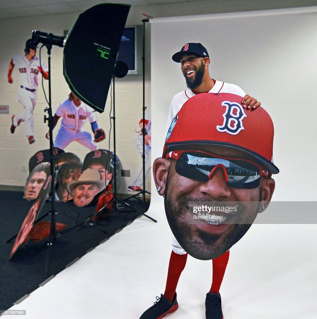 Boston Red Sox pitcher David Price has a laugh while holding an oversized cutout of his face as players posed for promotional photos during spring training at the Player Development Complex at Jet Blue Park in Fort Myers, FL on Feb. 20, 2018.