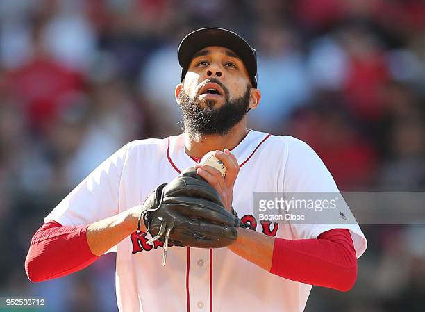 Boston Red Sox pitcher David Price takes a deep breath as he takes the mound in the 3rd inning after giving up a tworun home run at Fenway Park in...