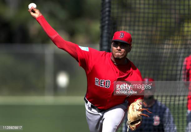 Boston Red Sox pitcher Denyi Reyes throws during a live batting practice session during a spring training workout at JetBlue Park in Fort Myers FL on...