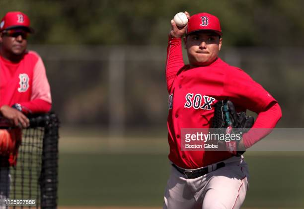 Boston Red Sox pitcher Erasmo Ramirez throws during a live batting practice session during a spring training workout at JetBlue Park in Fort Myers FL...