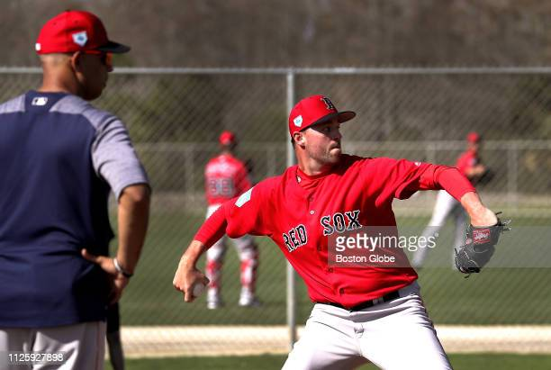 Boston Red Sox pitcher Heath Hembree throws a spring training bullpen session under the watchful eye of Red Sox manager Alex Cora at JetBlue Park in...