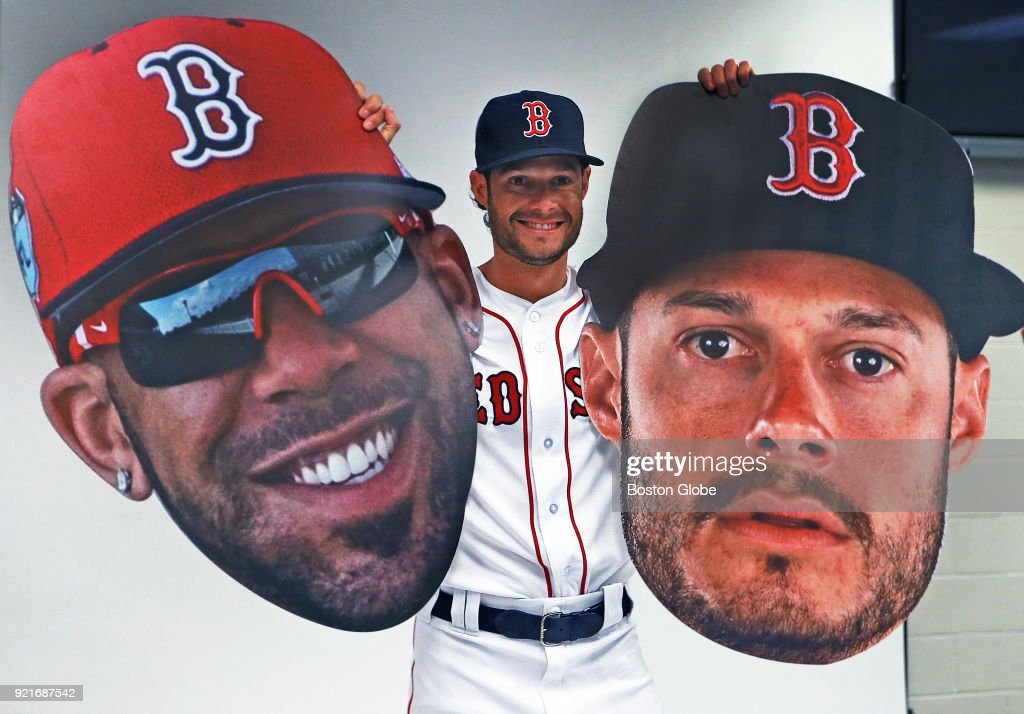 Boston Red Sox pitcher Joe Kelly holds up oversized cutouts of his own face, right, and that of teammate David Price as players posed for promotional photos during spring training at the Player Development Complex at Jet Blue Park in Fort Myers, FL on Feb. 20, 2018.