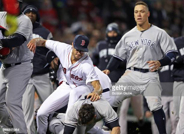 Boston Red Sox pitcher Joe Kelly punches the Yankees' Tyler Austin after Austin charged the mound in the seventh inning The Boston Red Sox host the...
