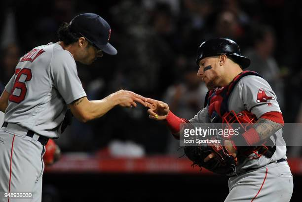 Boston Red Sox pitcher Joe Kelly with c archer Christian Vazquez after the Red Sox defeated the Los Angeles Angels of Anaheim 8 to 2 in a game played...