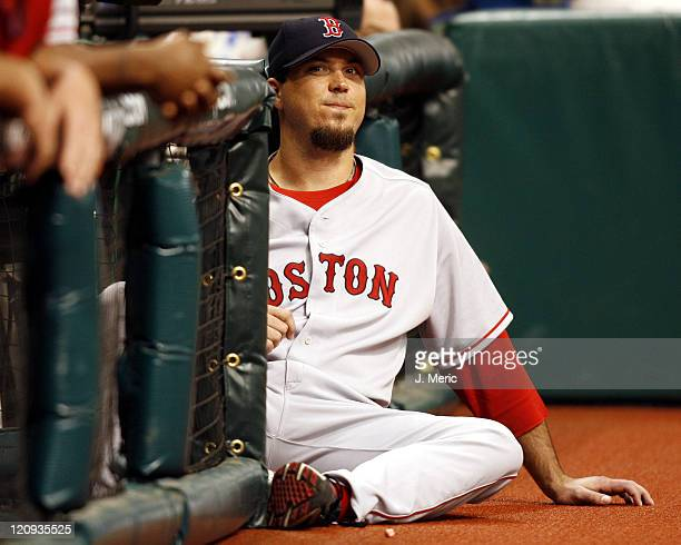 Boston Red Sox pitcher Josh Beckett sits at the end of the dugout and watches Wednesday night's game against Tampa Bay Devil Rays at Tropicana Field...
