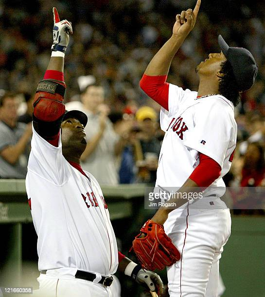 Boston Red Sox pitcher Pedro Martinez right and teammate David Ortiz point skyward after Martinez completed seven innings with a 41 lead against the...