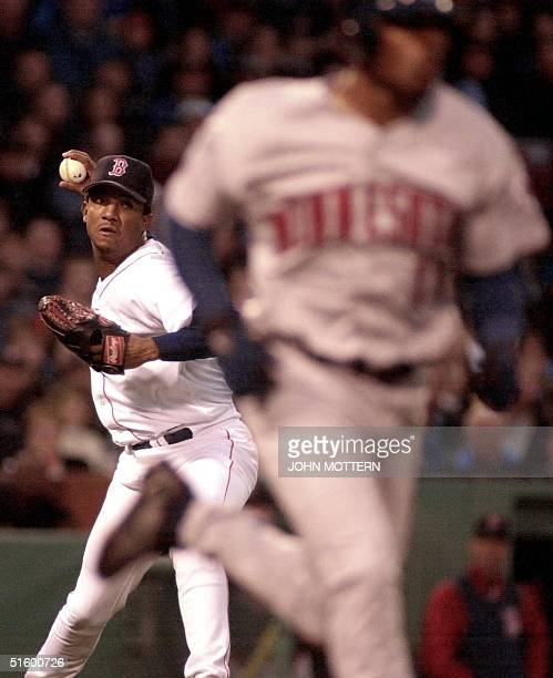 Boston Red Sox pitcher Pedro Martinez throws Jacque Jones of the Minnesota Twins out at first in the second inning 25 April 2001 at Fenway Park in...