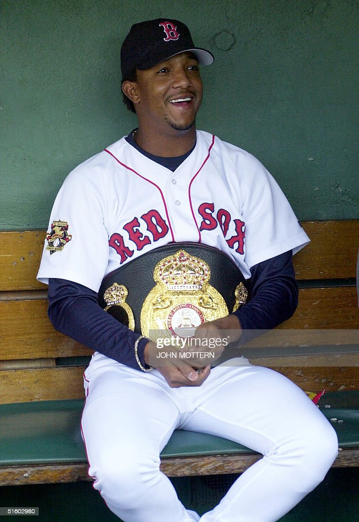 Boston Red Sox Pitcher Pedro Martinez tries on Joh : News Photo