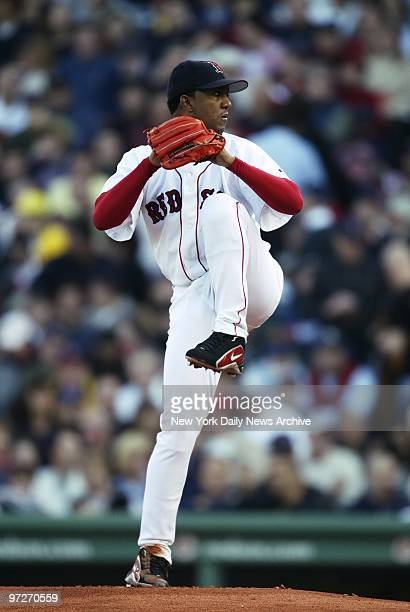 Boston Red Sox' pitcher Pedro Martinez winds up in the first inning of Game 3 of the American League Championship Series against the New York Yankees...
