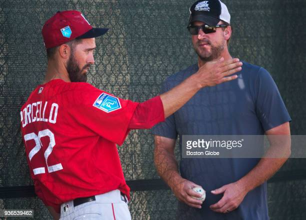 Boston Red Sox pitcher Rick Porcello chats with former Red Sox pitcher Derek Lowe who he invited to spring training to tutor him at Jet Blue Park in...