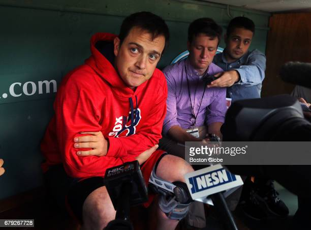 Boston Red Sox pitcher Steven Wright wears a knee brace as he talks to reporters in the dugout before the game at Fenway Park in Boston on May 04 2017