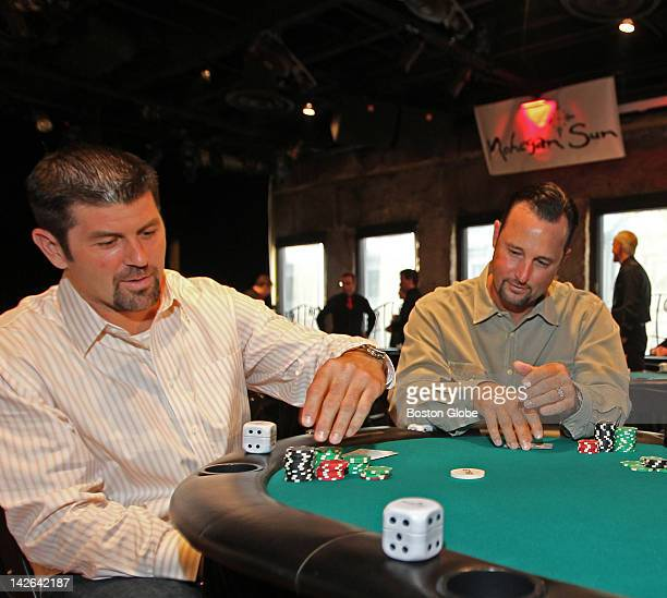 """Boston Red Sox pitcher, Tim Wakefield, right and catcher, Jason Varitek playing a warm up hand before their benefit, """"Pitching In For Kids,"""" at Ned..."""