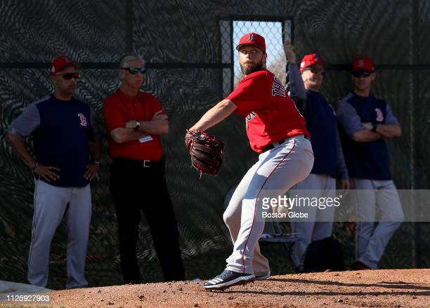 Boston Red Sox pitcher Tyler Thornburg throws a spring training bullpen session as Red Sox manager Alex Cora and Red Sox president of baseball...
