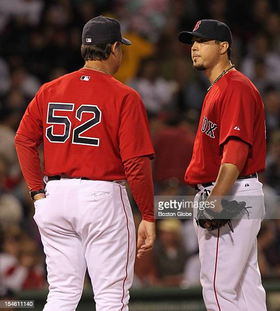 Boston Red Sox pitching coach John Farrell visits Josh Beckett on the mound after the New York Yankees' Francisco Cervelli's infield single during...