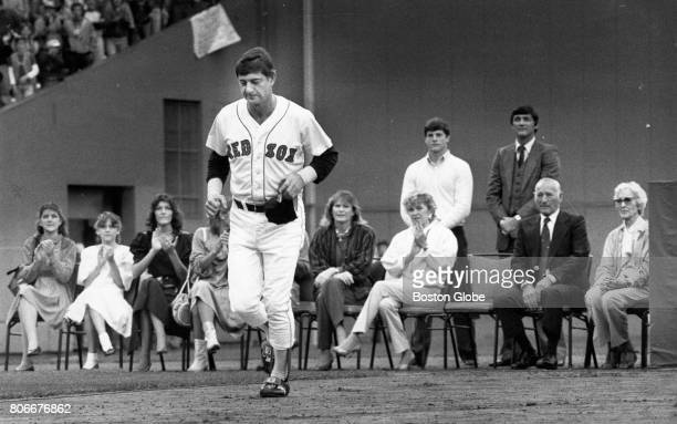 Boston Red Sox player Carl Yastrzemski leaves his seat to run around the field during a ceremony before his last game at Fenway Park on Oct 1 1983...
