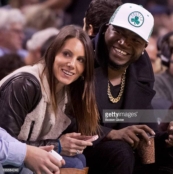 Boston Red Sox player David Ortiz and his wife Tiffany Ortiz sit court side during the Boston Celtics home opener against the Milwaukee Bucks at TD...