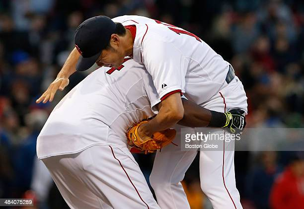 Boston Red Sox player David Ortiz picks up Red Sox closing pitcher Koji Uehara right as they celebrate their win against the Texas Rangers at the...