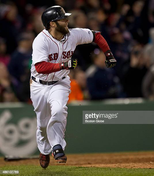 Boston Red Sox player Dustin Pedroia watches the flight of his double that drew a replay from manager John Farrell against the Baltimore Orioles...