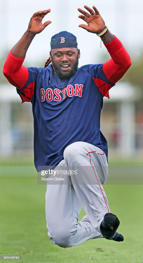 Boston Red Sox player Hanley Ramirez is airborne as he takes part in a sliding drill on the final day of workouts during spring training at the Player Development Complex at Jet Blue Park in Fort Myers, FL on Feb. 21, 2018. The team begins exhibition games with a doubleheader against college teams the following day.