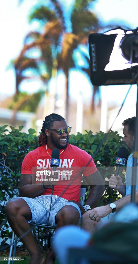 Boston Red Sox player Hanley Ramirez, left, sits down for a post-workout interview with interviewers from NBC Sports Boston, including Lou Merloni, right, during spring training at the Player Development Complex at Jet Blue Park in Fort Myers, FL on Feb. 18, 2018.