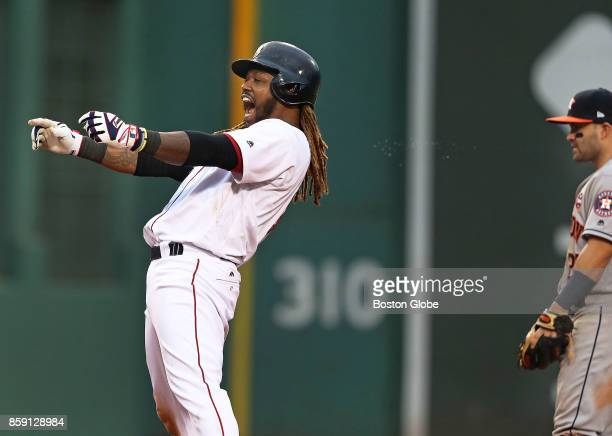 Boston Red Sox player Hanley Ramirez reacts to his teammates in the dugout after his bottom of the seventh inning two RBI double put Boston ahead 63...