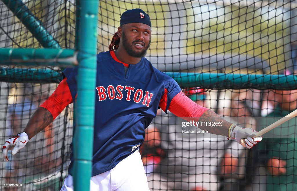 Boston Red Sox player Hanley Ramirez swings in a batting cage during spring training at the Player Development Complex at Jet Blue Park in Fort Myers, FL on Feb. 20, 2018.