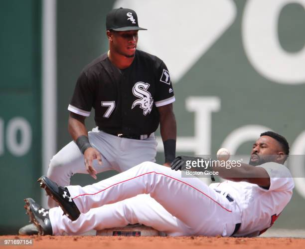 Boston Red Sox player Jackie Bradley Jr is safe stealing second base as Chicago White Sox player Tim Anderson cannot hold onto the ball during the...