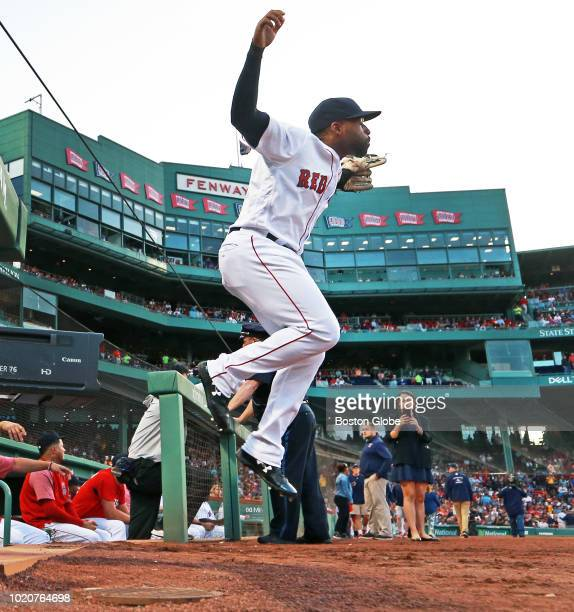 Boston Red Sox player Jackie Bradley Jr leaps out of the dugout as he takes the field for the start of the game The Boston Red Sox host the Cleveland...